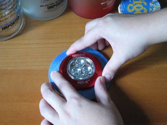 Glue the coasters together and put the light on the inside of the coasters.
