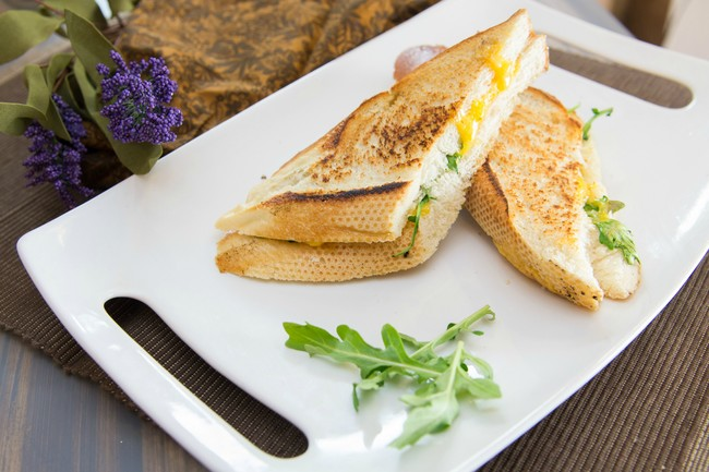 Arugula and cheddar grilled cheese with fig butter.