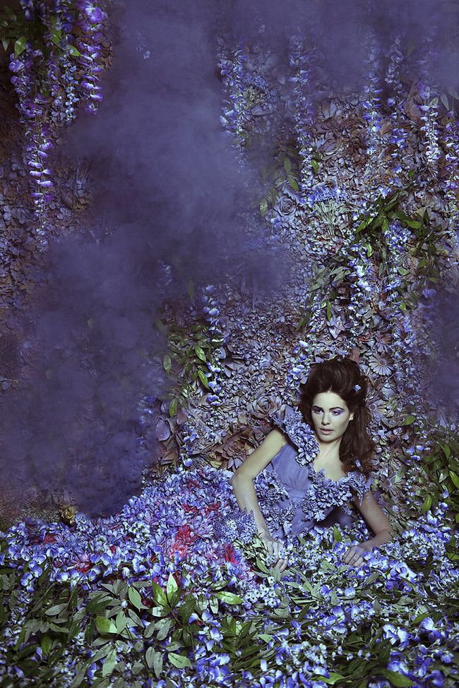 In this shoot, the model's dress was blended into her surroundings with dozens of purple silk flowers.