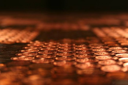 Once all the pennies were on the table, he coated it with a glossy epoxy varnish to seal it